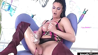 Busty ts goddess Domino Presley jerking with soft gel sleeve